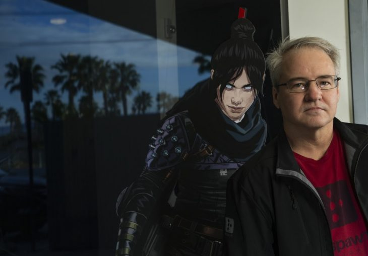 "Vince Zampella next to a figure of ""Apex Legends"""